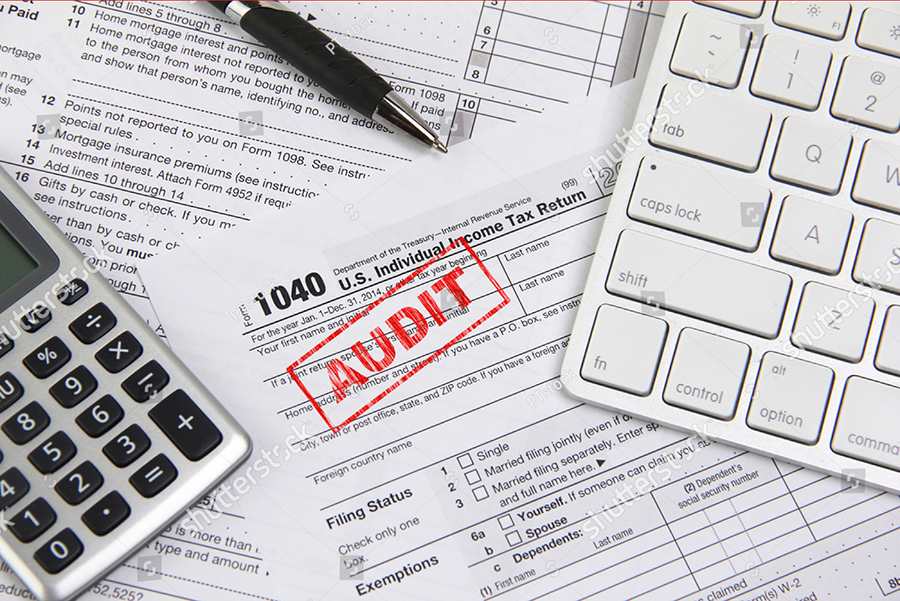 stock-photo-filing-taxes-online-using-a-computer-and-being-audited-253925581